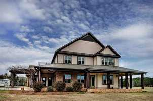 Beat the heat and spend lazy summer days by the pool in this beautiful Brandon home. the home includes five bedrooms, five bathrooms, and a large barn with space for holding horses. the home is featured onrealtor.com.