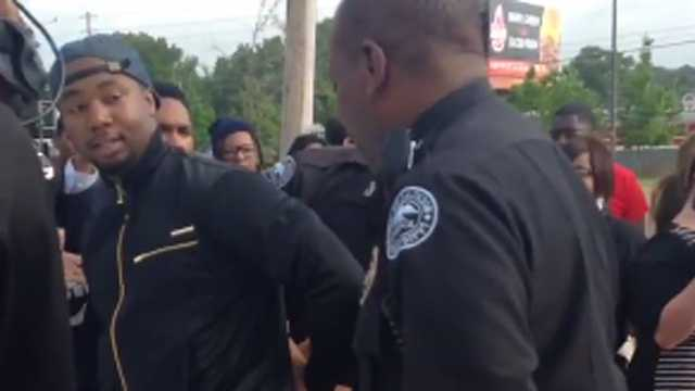 Jackson police took a man into custody during a rally seeking an increase to minimum wage.