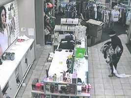 Surveillance cameras capture images of a burglary at a Jackson clothing store.