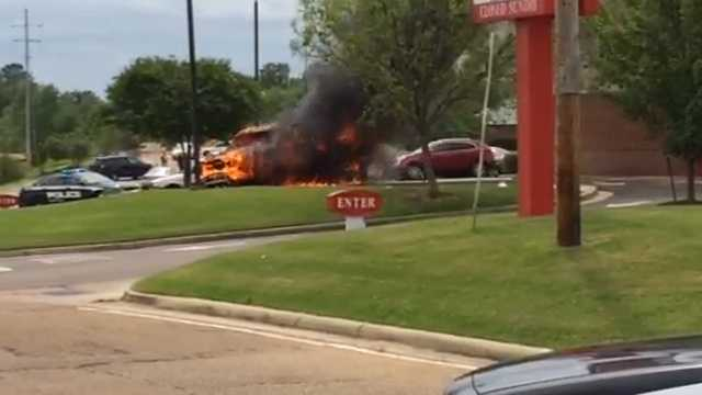 A pickup truck burns in the parking lot of the Chick-fil-A in Clinton.