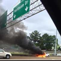 A good Samaritan stopped to help a woman moments before her vehicle went up in flames.