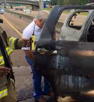Alex Sivira said he was driving Tuesday in the southbound lane of Interstate 55 past the Northside Drive exit, when he saw a woman in the northbound lane standing beside a vehicle that had just started to catch fire.