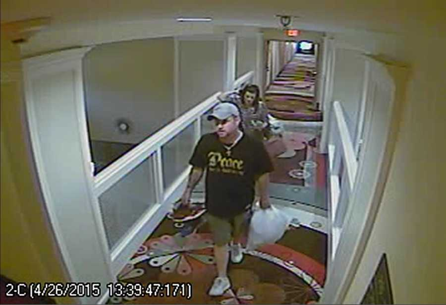 Flowood police have released surveillance photos of two people accused of stealing luggage from a hotel.