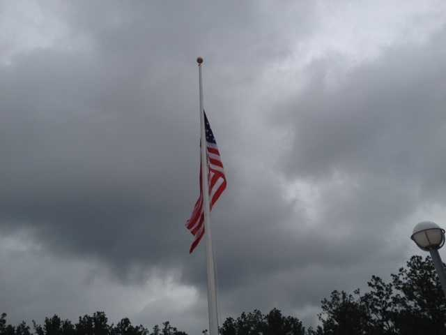 A flag was flown at half-mast outside the state's new crime lab in Pearl.