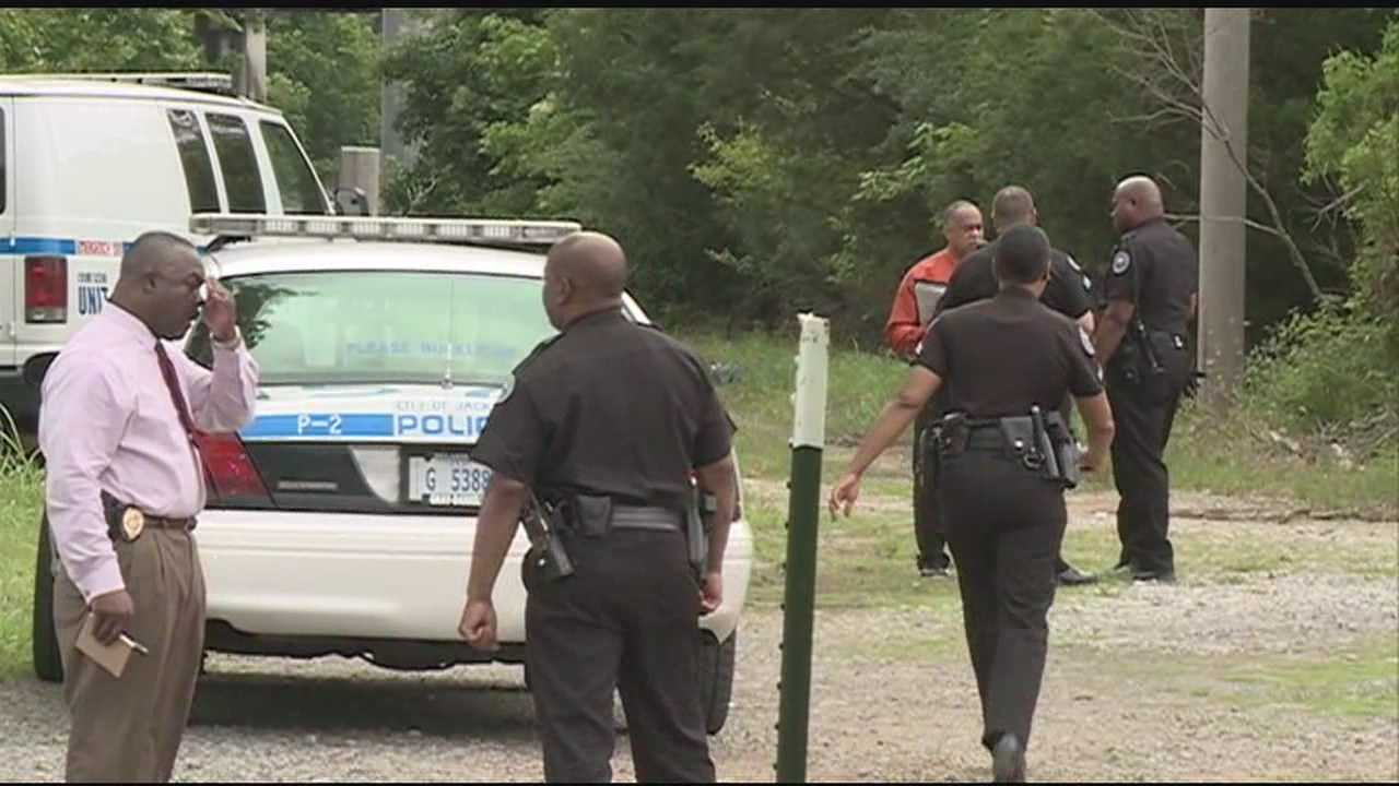 Someone found a decomposed body in the woods near Moody and Harris Street.