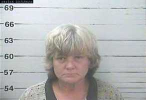 Tina Marie Gilleland is charged with embezzlement, Biloxi police say.