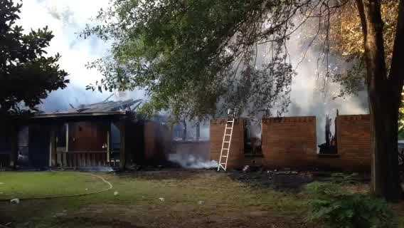A family was outside their burning home on Jasckson-Raymond Road when firefighters arrived Friday morning.