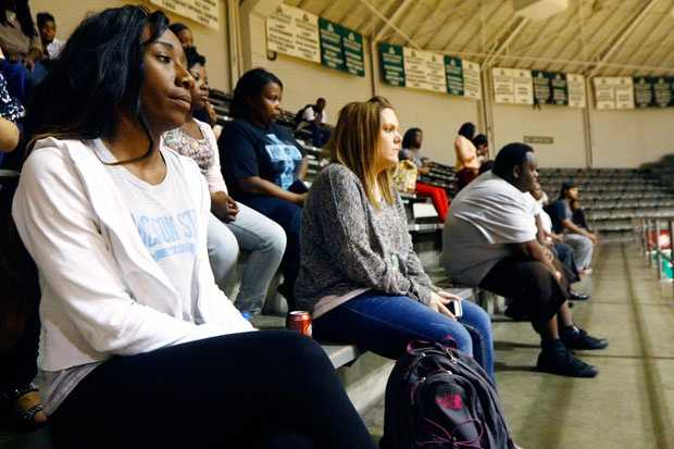 Delta State students waited at the coliseum for the lockdown to be lifted.
