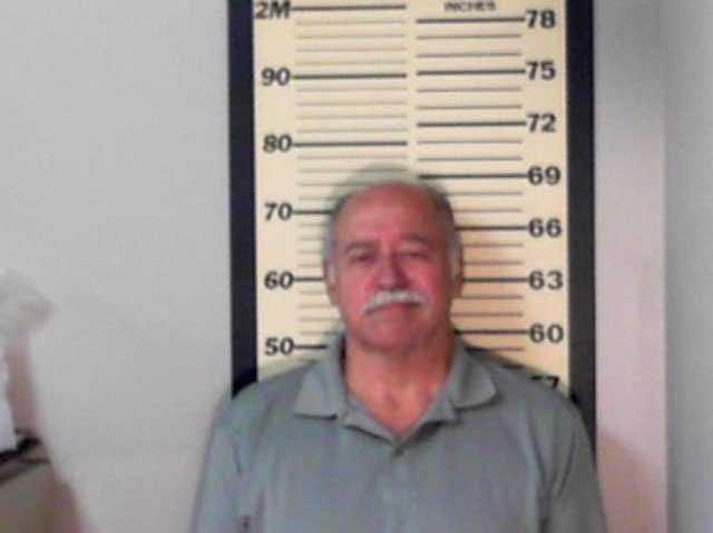 Everette E. Pennock, 69, of Crystal Springs, is charged with one count of embezzlement over $1,000, Madison police say.
