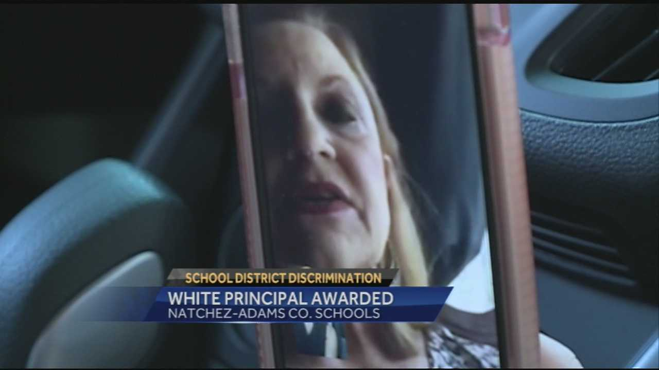 A federal jury awarded thousands of dollars to a Natchez principal who says was discriminated against because she's white.