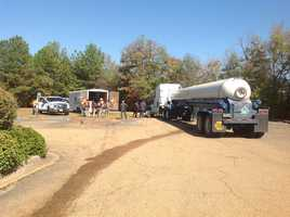 Byram fire, police and public works units worked Thursday to contain a fuel leak from a tanker truck that struck something on I-55 south at the Byram city limits.