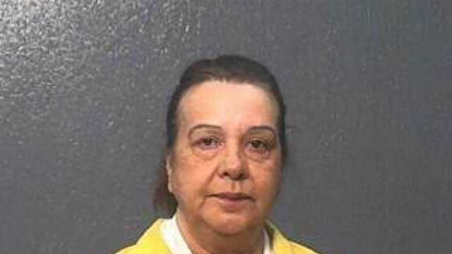 Shirley Atkinson, 52, is charged with eight counts of felony embezzlement, Gautier police say.