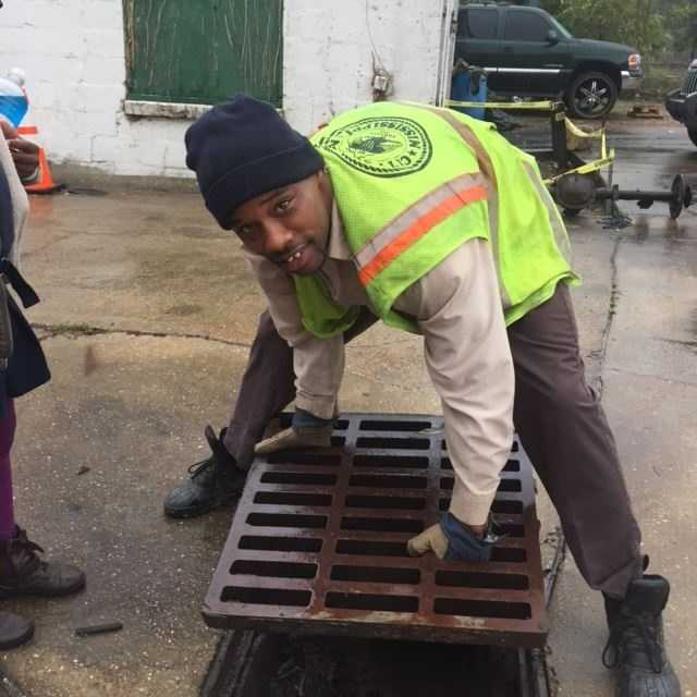 A city worker came out and removed the grate to free the puppy.