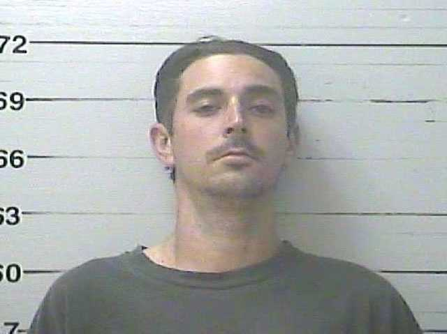 Casey Alden Louviere, 30, is charged with aggravated assault, the Harrison County Sheriff's Department says.