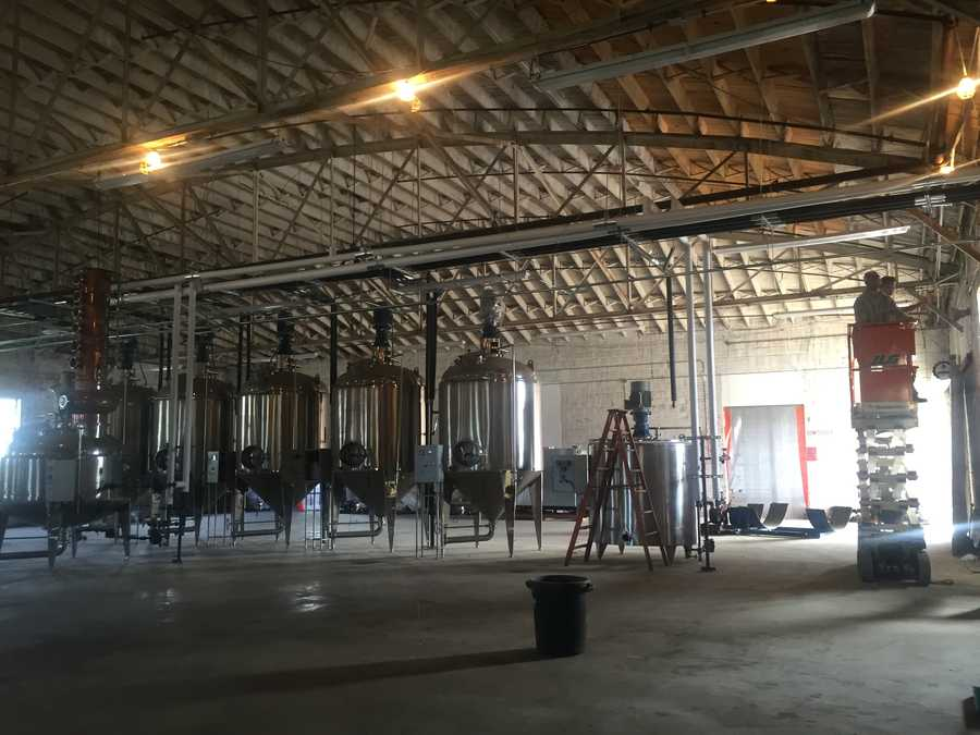 The 20,000-square-foot space at 422 S. Farish St. will allow the company to produce more spirits, including whiskey.