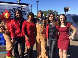 The ladies of 16 WAPT News thank a donor during Turkey Drive 16.