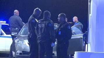 Jackson Police Chief Lee Vance speaks to officers at the scene of a fatal shooting Thursday night.