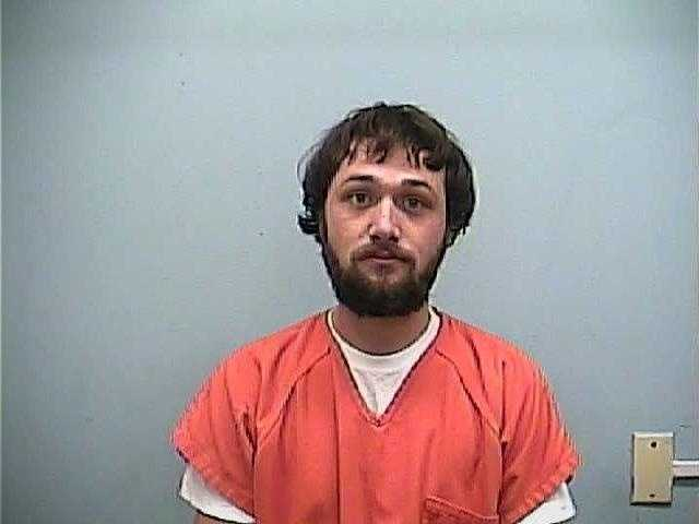 Zachary Miller, 22, is charged with shooting into a dwelling, the Adams County sheriff says.