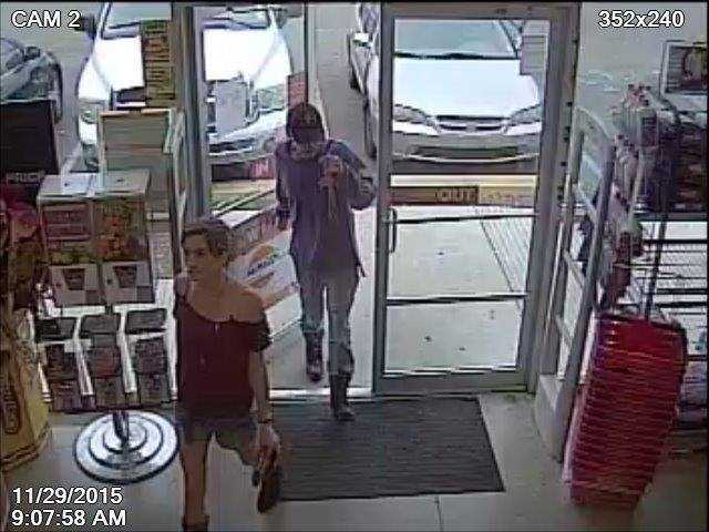 Byram police have released surveillance photos of two people wanted for questioning in connection with an auto burglary.