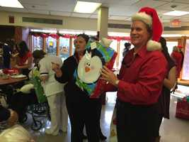 16 WAPT Chief Meteorologist David Hartman plays Santa at a Christmas party at Community Place Nursing Home.