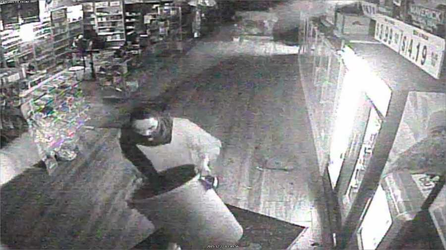 Police say the suspects broke the glass and entered a tobacco store at 3:50 a.m. Dec. 22.