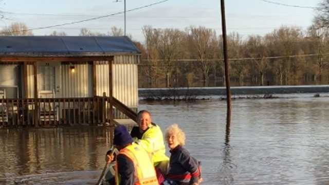 A Morton woman is rescued from her mobile home after it was surrounded by floodwater.