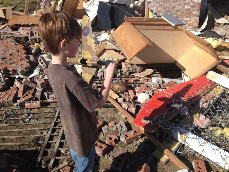 Families in the Strong Hope community in Copiah County try to salvage what they can after a tornado struck Monday.