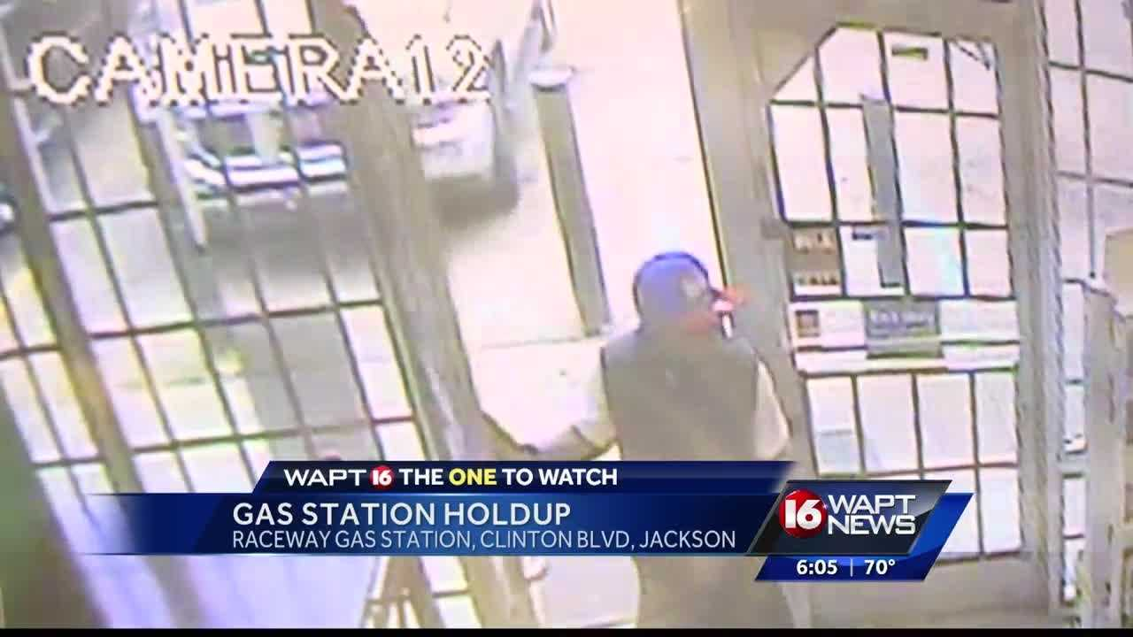 The suspect was caught on camera pointing a gun at the cashier.
