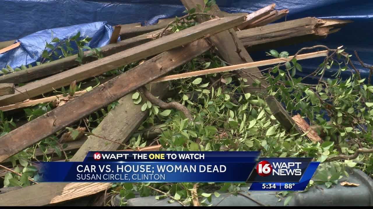 A woman is dead after her car slammed into a house in Clinton.