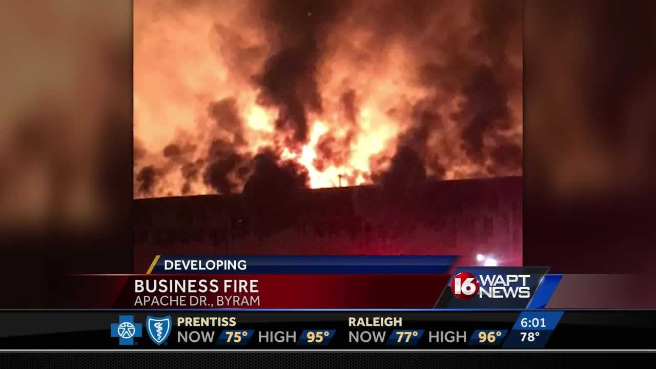 Flames were seen tearing through a building on Apache Drive.
