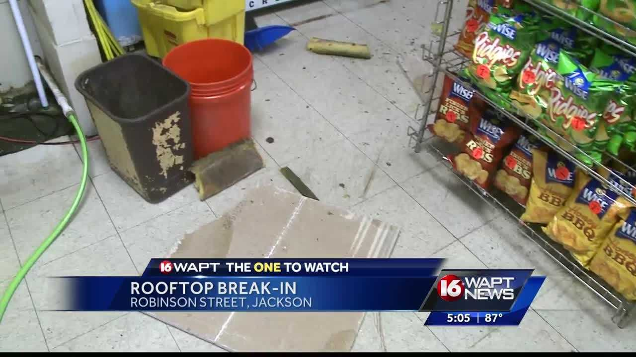 Police are searching for the person who busted a hole in the roof and stole items from the store.