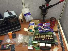 A search warrant at a home on Cherry Stone Drive in Clinton results in the seizure of drugs, weapons and ammunition reloading equipment, police say.