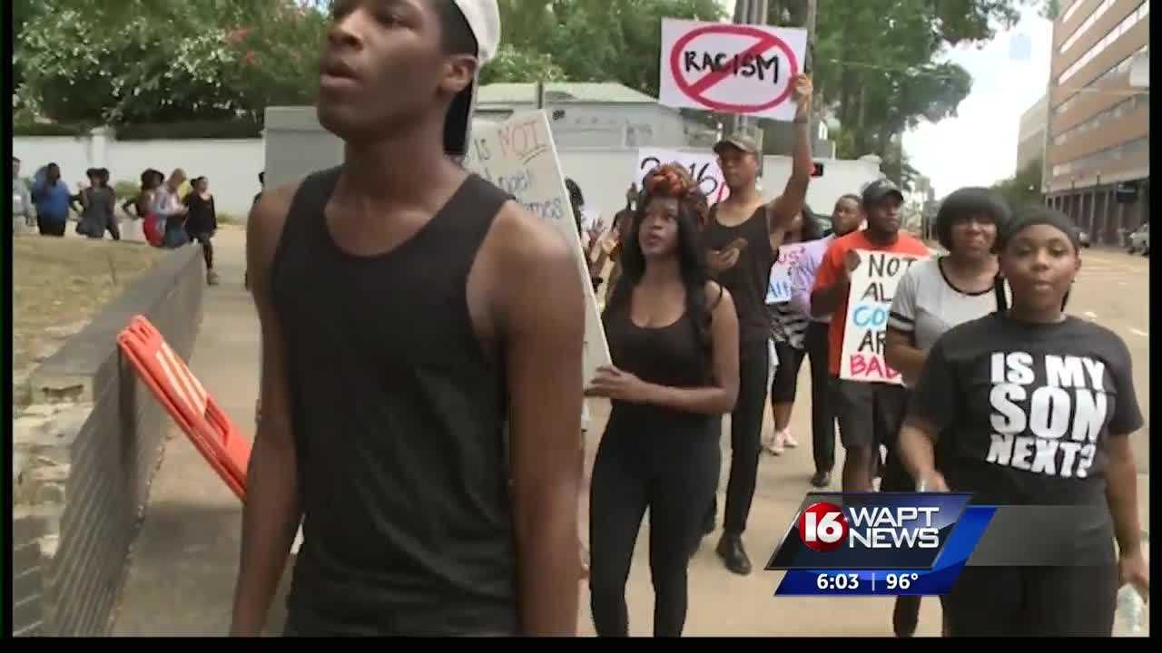 A group of men and women gathered at Smith Park Friday evening and walked through downtown Jackson protesting the recent violence across the country.