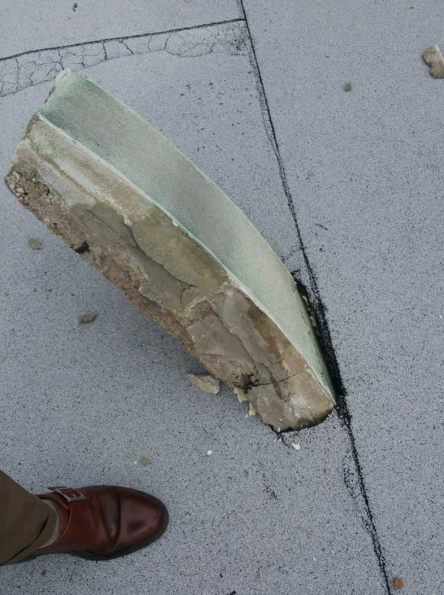 One of the stones fell and penetrated into the building's roof.