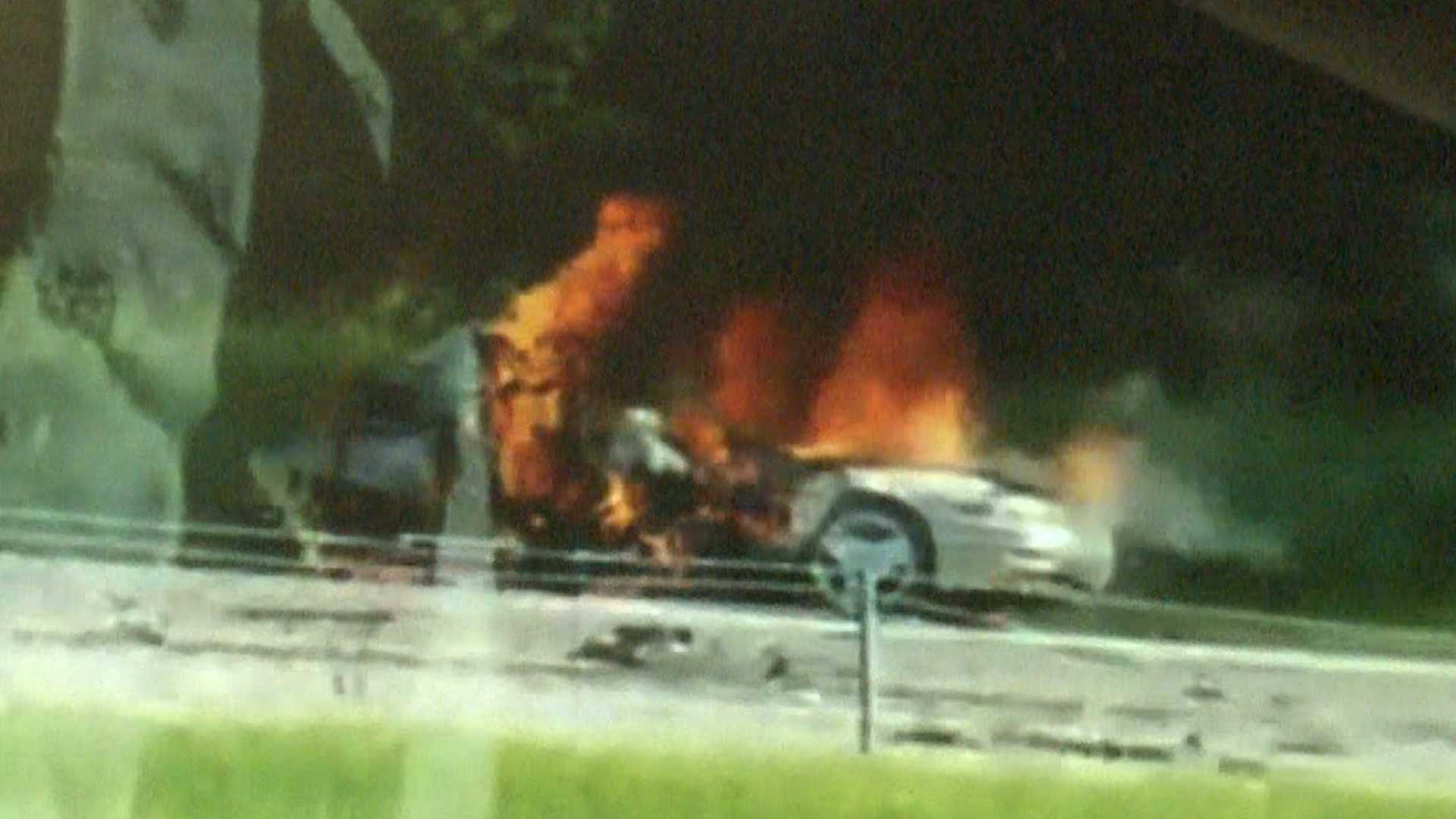 A still from a video captured by a witness shows one of the cars involved in the crash engulfed in flames.