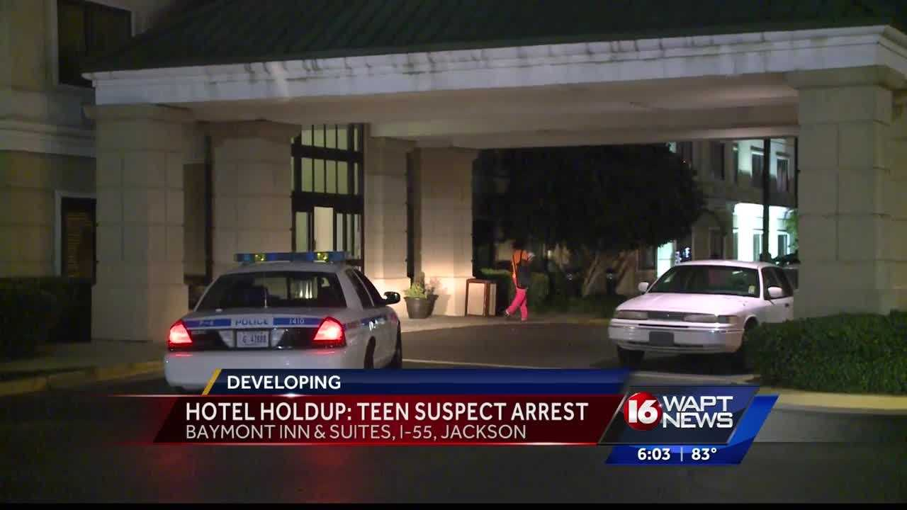 Police say a 16-year-old robbed a woman at gunpoint outside a hotel