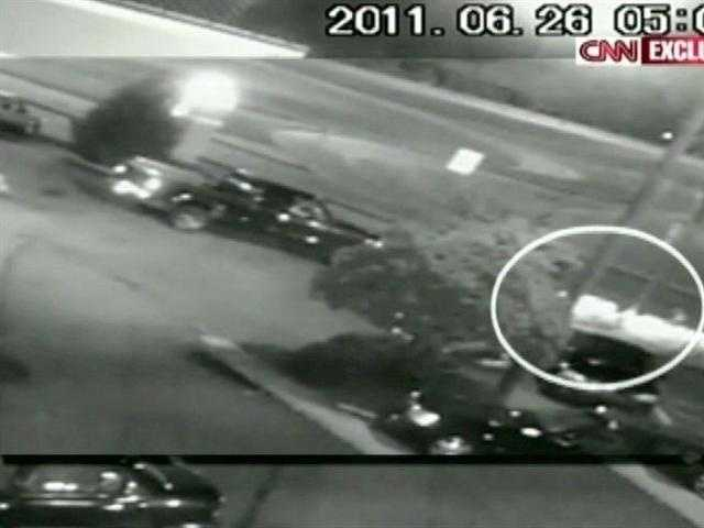 CNN airs surveillance video in early August 2011 from the Metro Inn that prosecutors say shows Anderson's beating and the truck running him down.