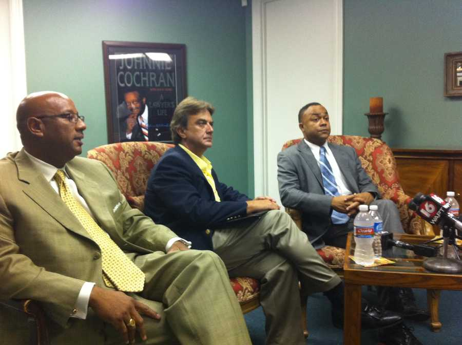 Hinds County District Attorney Robert Smith, far right, seeks to have Dedmon's bond revoked.