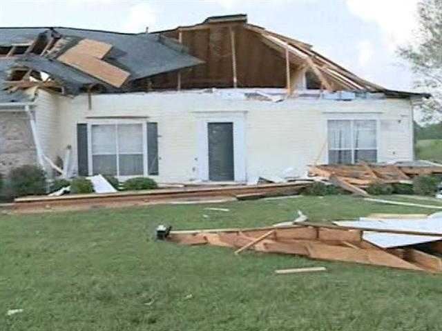 A tornado sweeps through Terry, damaging houses and ripping up trees.