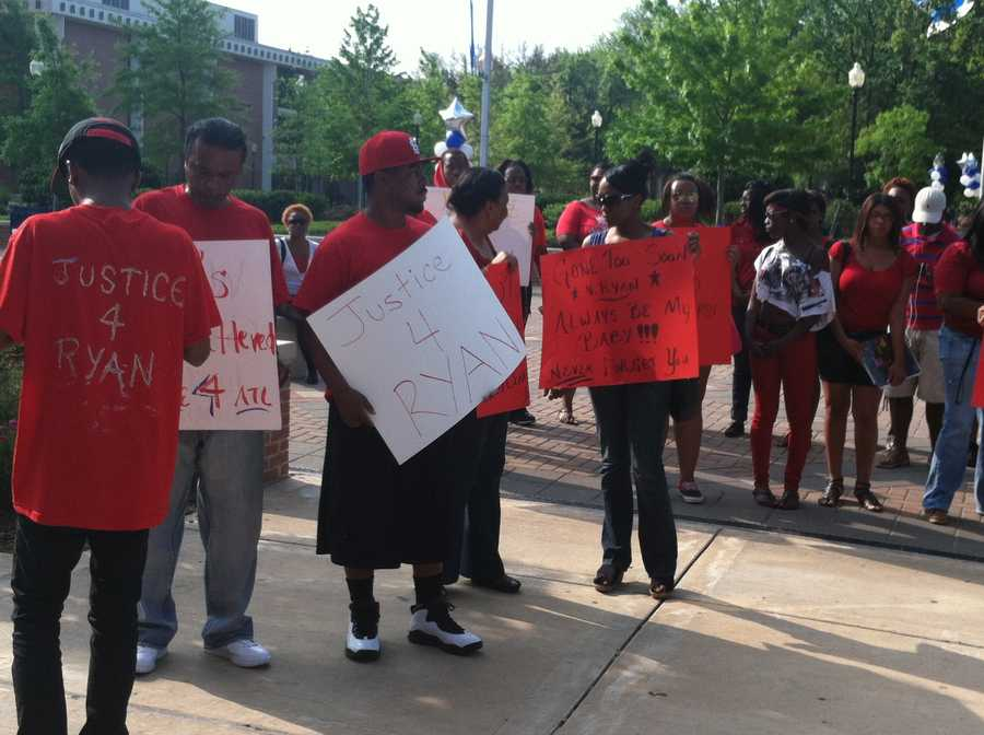 Students held a rally on campus Wednesday morning in Henderson's honor.