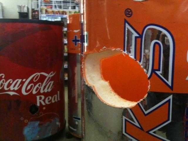 A section of this drink cooler was removed with bullet still lodged in it. Click here for more images.