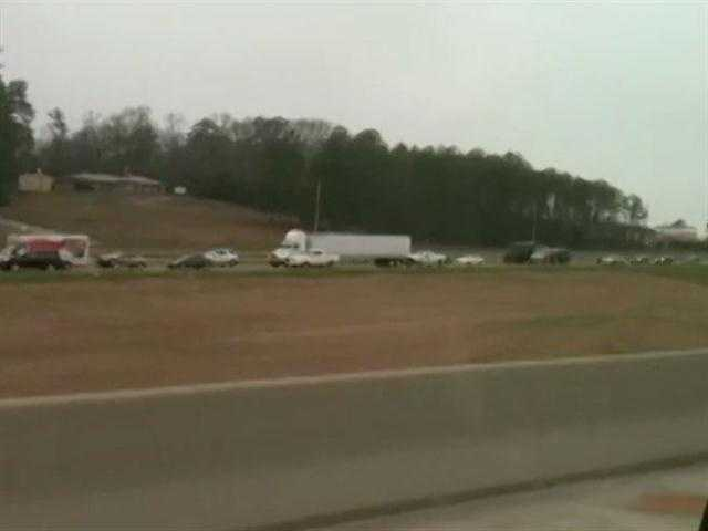 An 18-wheeler loses its load of railroad ties, which leads to a traffic back up on Interstate 20 eastbound in Jackson.