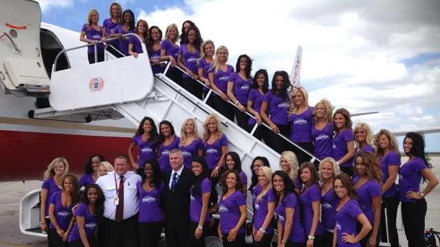 It's not often the pilot asks for a photo with his passengers, but you can bet this was a chance not to be overlooked.