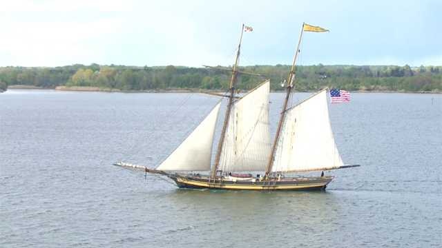 The schooner sails into Annapolis with cannons ablaze, as seen in these photos from SkyTeam 11.