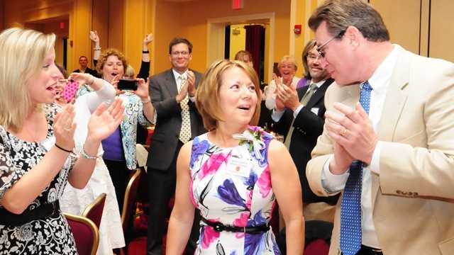 Martha Gardner reacts to the surprise announcement naming her teacher of the year.