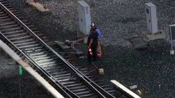 A small fire ignites on subway train tracks in Baltimore County, stranding a train full of passengers.