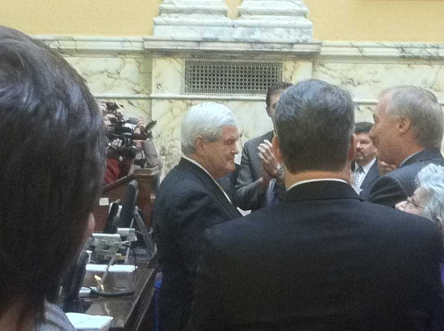 Newt Gingrich is greeted by lawmakers inside the Maryland State House.