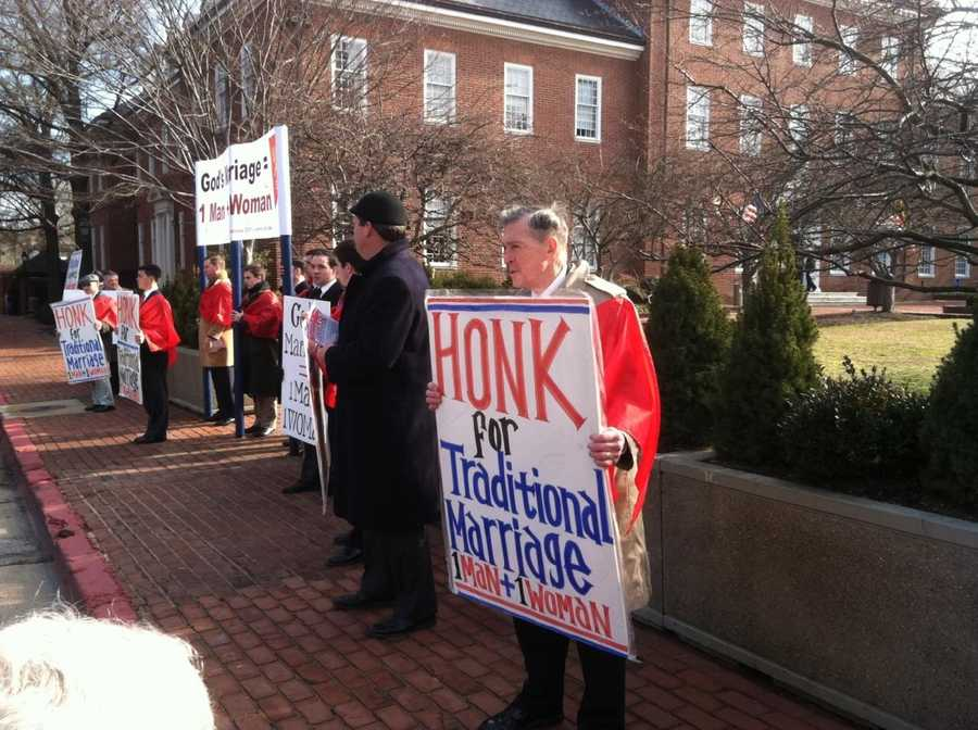 Opponents rallied outside the State House on the day of the vote.
