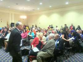 Opponents and advocates alike crowd into a room to be part of the hearing on same sex marriage.
