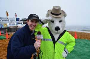 WBAL-AM reporter Scott Wykoff hangs with the polar bear mascot.